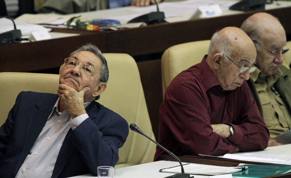 FILE - In this Dec. 18, 2010 file photo, Cuban President Raul Castro gestures next to Vice Presidents Jose Ramon Machado Ventura, center, and Abelardo Colome, right, during the closing ceremony of the second annual session of Cuba's National Assembly in Havana, Cuba. On Friday, April 16, 2021, Castro formally announced he'd step down as head of the Communist Party, leaving Cuba without a Castro in an official position of command for the first time in more than six decades. (AP Photo/Franklin Reyes, File)
