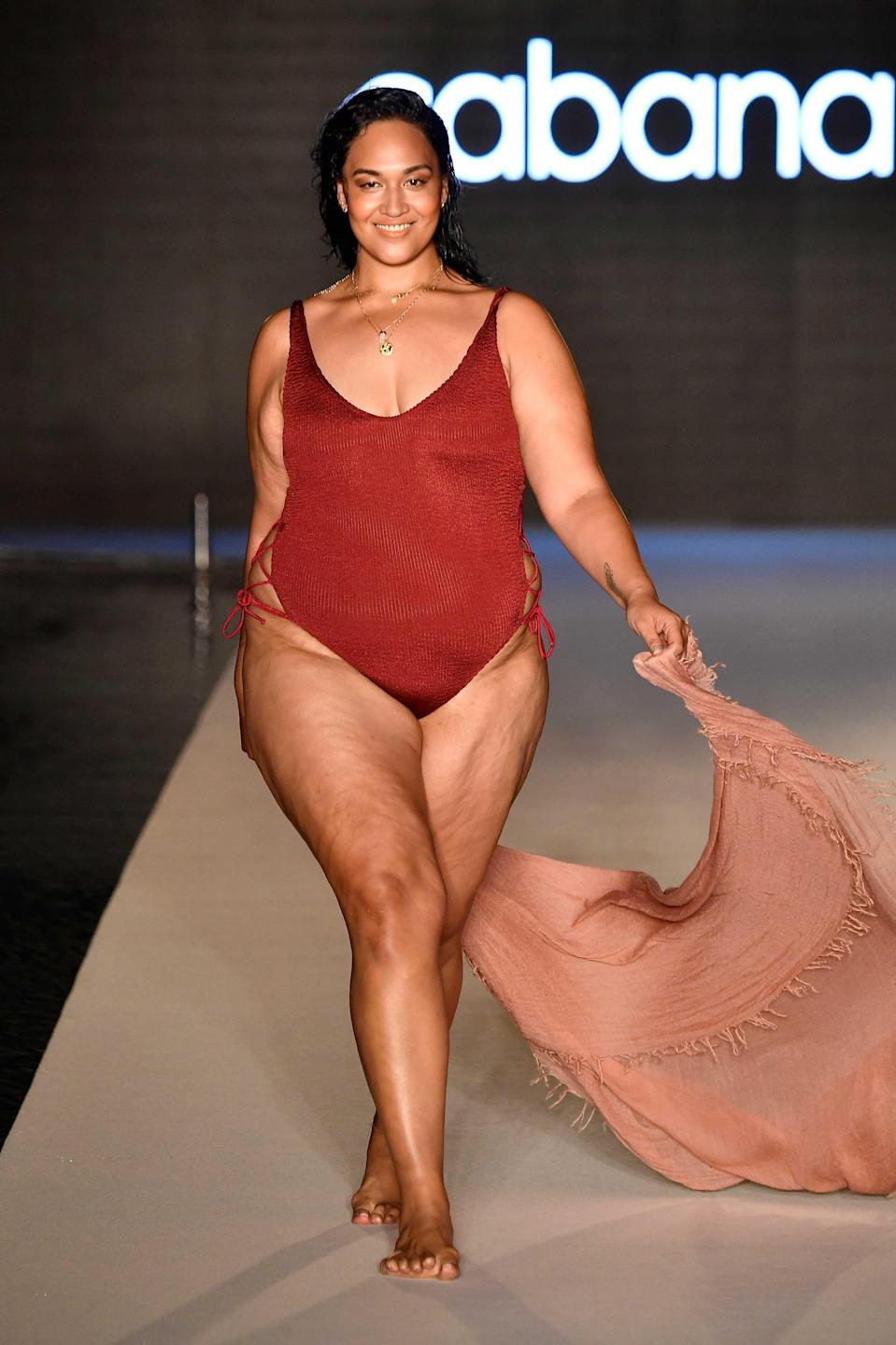 <p>A model walks the runway wearing a red hot one-piece swimsuit for the 2018 <em>Sports Illustrated</em> swimsuit show during Miami Swim Week at the W South Beach hotel on July 15. (Photo: Alexander Tamargo/Getty Images for Sports Illustrated) </p>