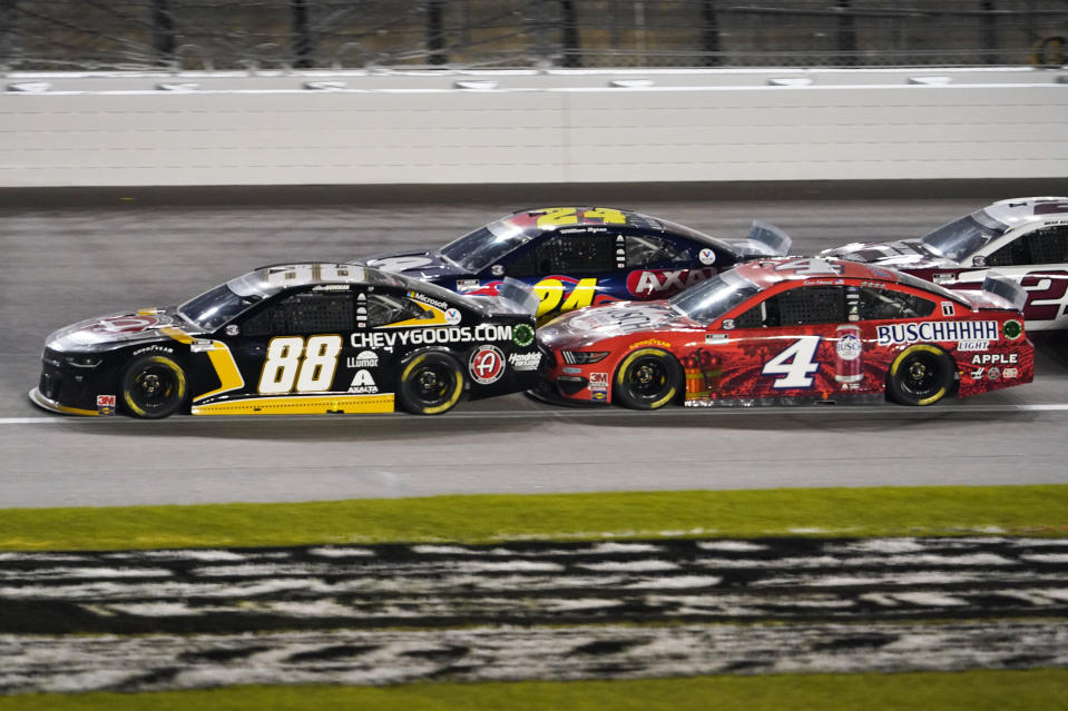 Alex Bowman (88), William Byron (24) and Kevin Harvick (4) battle during a NASCAR Cup Series auto race at Kansas Speedway in Kansas City, Kan., Thursday, July 23, 2020. (AP Photo/Charlie Riedel)