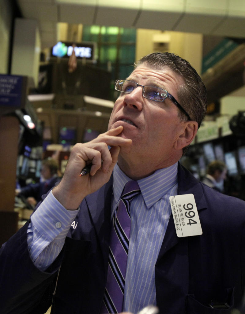 Stocks waver; signs on the economy hard to read