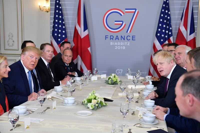 US President Donald Trump (2nd L) and Britain's Prime Minister Boris Johnson (3rd R) attend a working breakfast in Biarritz, south-west France on August 25, 2019, on the second day of the annual G7 Summit attended by the leaders of the world's seven richest democracies, Britain, Canada, France, Germany, Italy, Japan and the United States. (Photo by Nicholas Kamm / AFP) (Photo credit should read NICHOLAS KAMM/AFP/Getty Images)