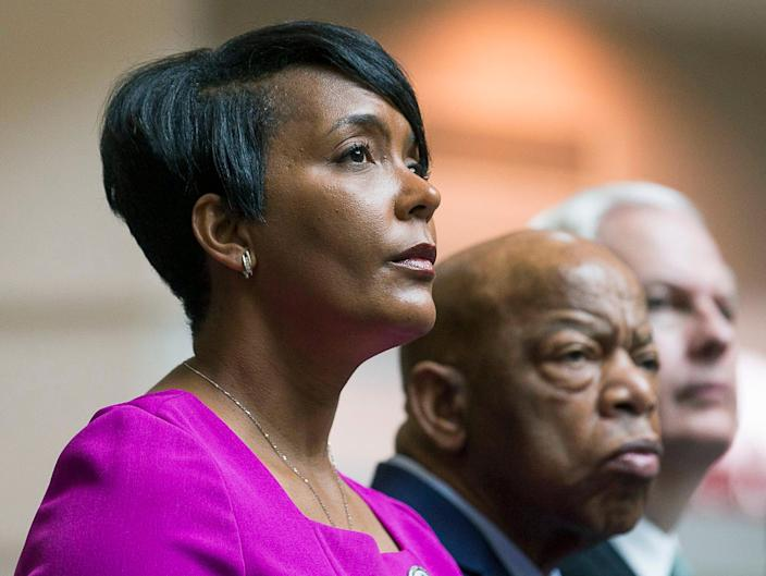 Atlanta Mayor Keisha Lance Bottoms, left, sits with U.S. Rep. John Lewis during a tribute to Lewis this month at Atlanta's Hartsfield Jackson International Airport. Some students at Spelman College aren't happy that the mayor will be their commencement speaker this year.