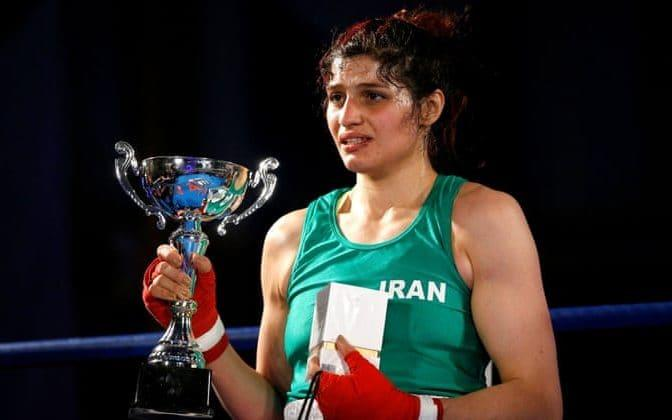Sadaf Khadem is presented with the trophy after beating Anne Chauvin in their boxing match in Royan.  - Reuters