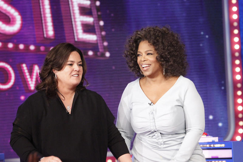 """FILE - In this Oct. 10, 2011 file image released by Harpo, Inc., Oprah Winfrey, right, is shown with host Rosie O'Donnell during the debut of """"The Rosie Show,"""" in Chicago. Oprah Winfrey's struggling network, OWN, is laying off 30 workers and restructuring its operations in New York and Los Angeles.  On Friday, March 16,  OWN announced the curtain on """"The Rosie Show"""" will be on March 30, after five months on the air. (AP Photo/Harpo, Inc., George Burns/file)"""