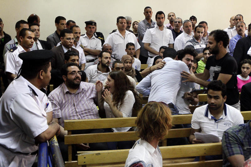 Colleagues and family members react to a court verdict convicting 43 nonprofit workers, including at least 16 Americans, of illegally using foreign funds to foment unrest in the country, sentencing them to up to five years in jail, in Cairo, Egypt, Tuesday, June 4, 2013. Present at Tuesday's hearing was American Robert Becker, who received a two-year sentence. Becker has maintained that his refusal to flee Egypt with fellow Americans who were in the country at the time of the crackdown on nonprofit groups was to show solidarity with his Egyptian colleagues. (AP Photo/Ahmed Abd El Latif, El-Shoruk Newspaper) EGYPT OUT