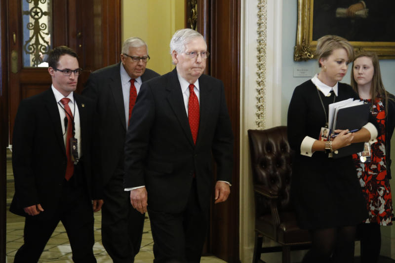 Senate Majority Leader Mitch McConnell, R-Ky., center, walks out of the Senate chamber at the Capitol Tuesday, Jan. 21, 2020, in Washington. President Donald Trump'simpeachment trialquickly burst into a partisan fight Tuesday as proceedings began unfolding at the Capitol.  (AP Photo/Steve Helber)