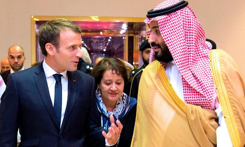 A handout picture provided by the Saudi Royal Palace on November 9, 2017, shows Saudi Crown Prince Mohammed bin Salman (R) receiving French President Emmanuel Macron (L) in the capital Riyadh on Thursday