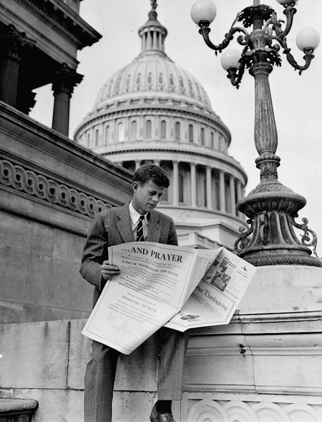 <p>Rep. John F. Kennedy, D-Mass., is shown looking through newspaper real estate ads on Capitol Hill in Washington, Nov. 27, 1946. (Photo: AP) </p>