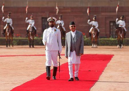 Nepal's Prime Minister Khadga Prasad Sharma Oli inspects a guard of honour during his ceremonial reception at the forecourt of India's Rashtrapati Bhavan presidential palace in New Delhi, India, April 7, 2018. REUTERS/Altaf Hussain