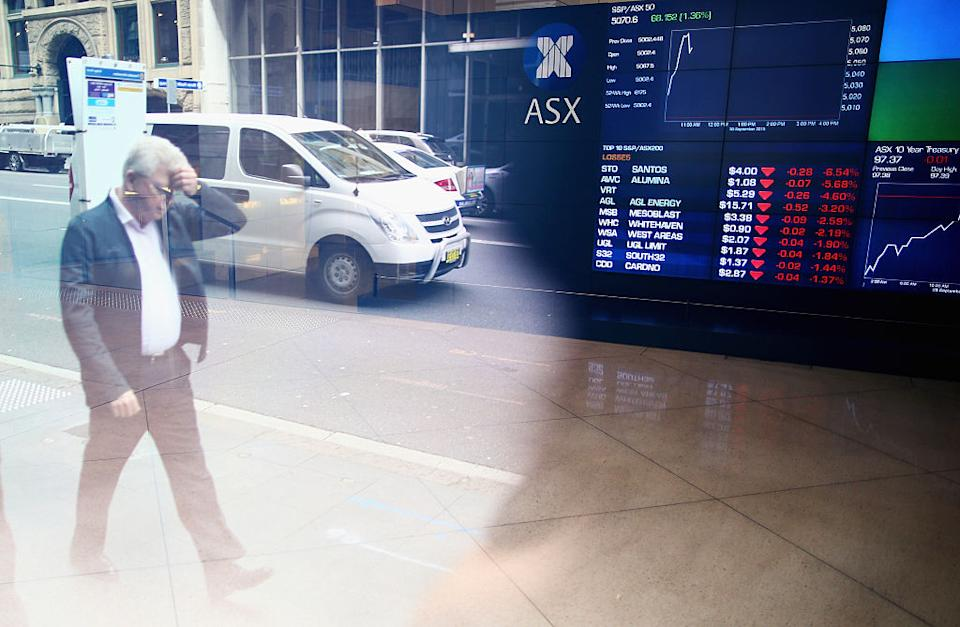 A man walks past the ASX Exchange Centre on September 30, 2015 in Sydney, Australia.