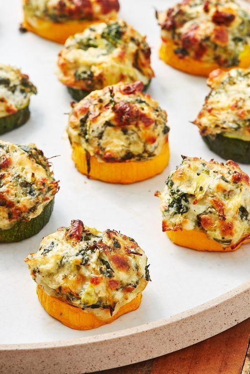"""<p>These little guys are scary addictive. Just as the courgette becomes tender, the cheese is getting melty and delicious. If you want a little extra colour on your bites, switch the oven to grill on medium and cook them a couple minutes more. (Just keep an eye on them.)</p><p>Get the <a href=""""https://www.delish.com/uk/cooking/recipes/a33664100/spinach-artichoke-zucchini-bites-recipe/"""" rel=""""nofollow noopener"""" target=""""_blank"""" data-ylk=""""slk:Spinach Artichoke Courgette Bites"""" class=""""link rapid-noclick-resp"""">Spinach Artichoke Courgette Bites</a> recipe.</p>"""