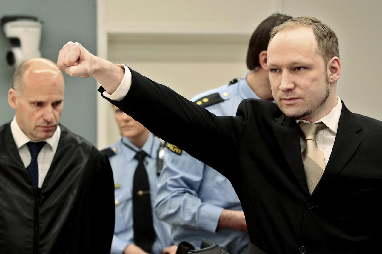 Accused Norwegian Anders Behring Breivik gestures as he arrives at the courtroom, Monday, April 16, 2012 in Oslo, Norway. The terror trial against an anti-Muslim fanatic who confessed to killing 77 people in Norway starts amid worries that he will use the proceedings to showcase his radical views. After opening statements, Anders Behring Breivik is set to testify for five days, explaining why he set off a bomb in downtown Oslo, killing eight, and then shot to death 69 people, mostly teenagers, at a Labor Party youth camp on Utoya island, outside the Norwegian capital.(AP Photo/Hakon Mosvold Larsen, Pool)