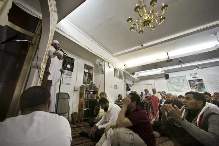 Dr. Muhamad Albar, far left, speaks to a congregation during Jumu'ah prayer service at the Islamic Society of Bay Ridge mosque on Friday, Aug. 16, 2013 in the Brooklyn borough of New York. The New York Police Department targeted this mosque as a part of a terrorism enterprise investigation beginning in 2003, spying on it for years. The mosque has never been charged as part of a terrorism conspiracy. (AP Photo/Bebeto Matthews)