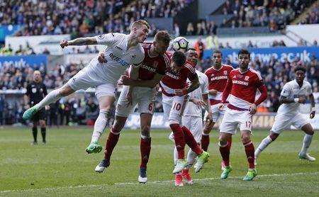 Britain Football Soccer - Swansea City v Middlesbrough - Premier League - Liberty Stadium - 2/4/17 Swansea City's Alfie Mawson in action with Middlesbrough's Ben Gibson Action Images via Reuters / Andrew Boyers Livepic