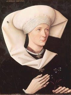 Renaissance Portrait of a woman with a fly on her head.