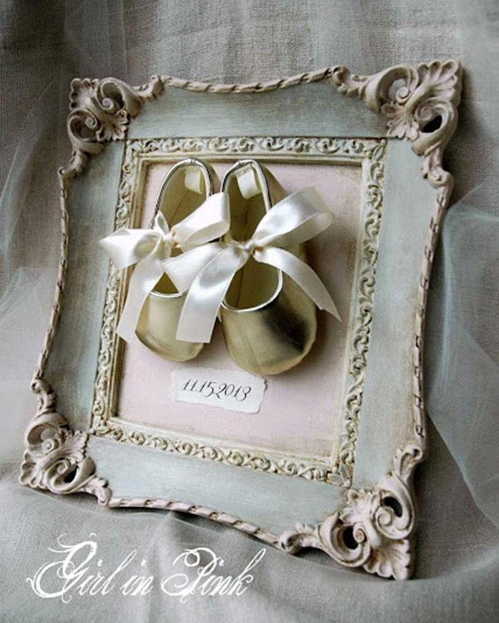 "<p>Showcase a special family event or memory by framing booties, baby shoes, a baby bonnet, a christening gown, or even a piece of lace from Grandma's wedding gown.</p><p><br></p><p><strong>See more at <a href=""http://onegirlinpink.blogspot.com/2013/11/a-keepsake-for-special-day.html"" rel=""nofollow noopener"" target=""_blank"" data-ylk=""slk:One Girl In Pink"" class=""link rapid-noclick-resp"">One Girl In Pink</a>.</strong></p>"
