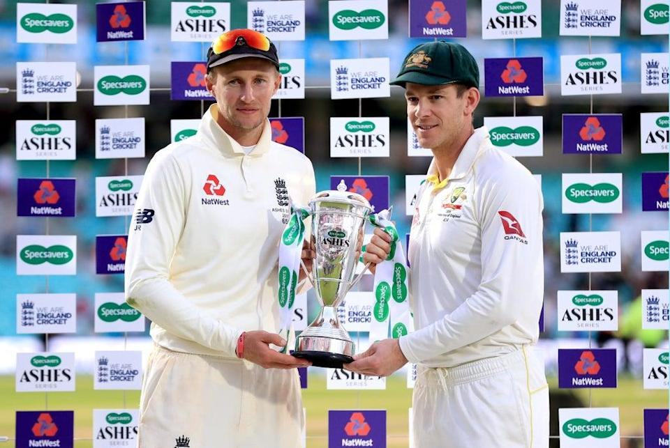 England captain Joe Root, left, is yet to commit to the Ashes tour but Australia counterpart Tim Paine is bullish it will go ahead (Mike Egerton/PA) (PA Archive)