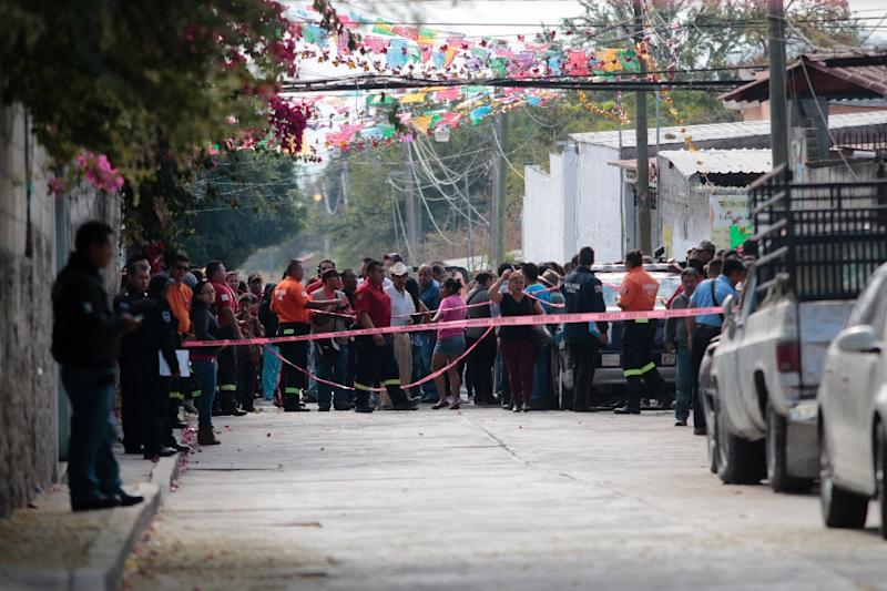 Local residents gather on January 2, 2016 outside the house of Gisela Mota, newly elected Mayor of Temixco, who was murdered at home by gunmen (AFP Photo/Pedro Pardo)