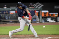 Boston Red Sox's Bobby Dalbec hits a two-run single against the Baltimore Orioles in the third inning of a baseball game, Saturday, May 8, 2021, in Baltimore. (AP Photo/Will Newton)