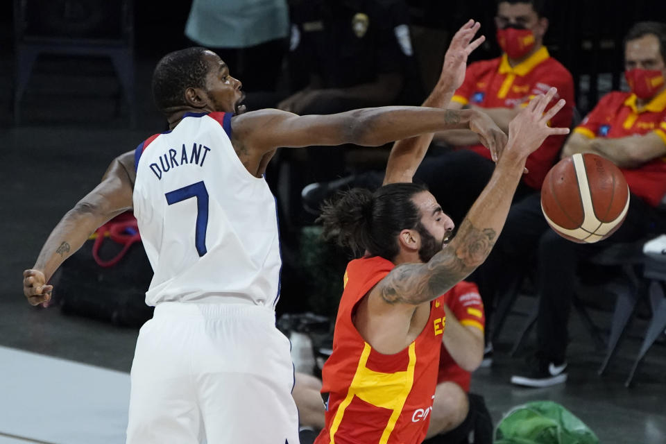 United States' Kevin Durant (7) blocks a shot by Spain's Ricky Rubio (9) during the first half of an exhibition basketball game in preparation for the Olympics, Sunday, July 18, 2021, in Las Vegas. (AP Photo/John Locher)