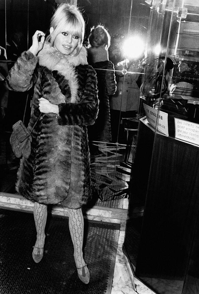 <p>The '60s brought a major cultural shift away from the conventional. Brigitte Bardot brings that mentality to her fall fashion, including a long fur coat, patterned stockings, and modern bangs.</p>