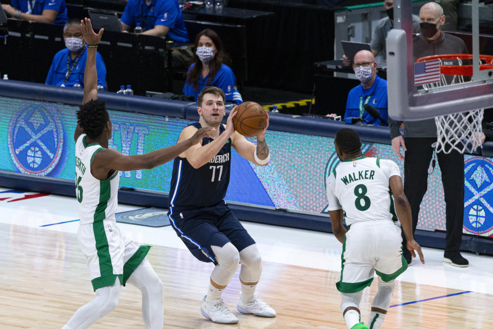 Dallas Mavericks guard Luka Doncic (77) shoots as Boston Celtics forward Aaron Nesmith (26) attempts to defend during the second half of an NBA basketball game in Dallas, Tuesday, Feb. 23, 2021. (AP Photo/Sam Hodde)