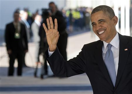 U.S. President Barack Obama waves upon arriving to attend the Nuclear Security summit (NSS) in The Hague March 24, 2014. REUTERS/Marco de Swart/Pool