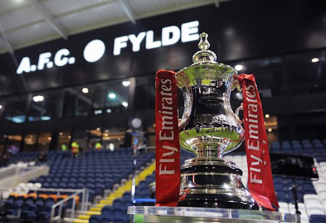 The FA Cup trophy sits pitchside for a match at AFC Fylde. The non-league side almost reached the third round, but fell to Wigan Athletic in a second-round replay. (Getty)