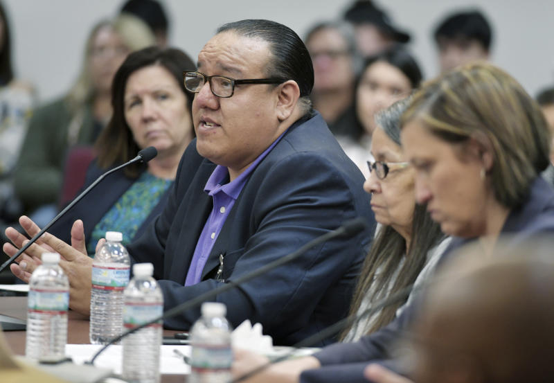 Charles Walker, left, representing the Standing Rock Sioux Tribe, testifies on 4-16-2019 in front of the House Administration Subcommittee on Elections at a field hearing in Fort Yates, N.D., related to voting rights and election administration accountability. (Mike McCleary/The Bismarck Tribune via AP)