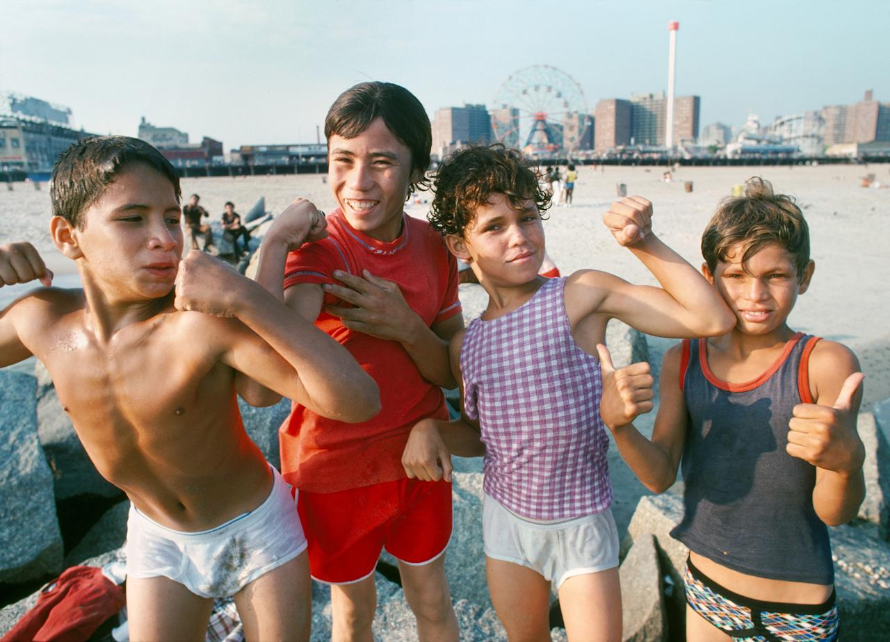 <p>Boys on Coney Island Beach. (Photograph by Paul Hosefros/NYC Parks Photo Archive/Caters News) </p>
