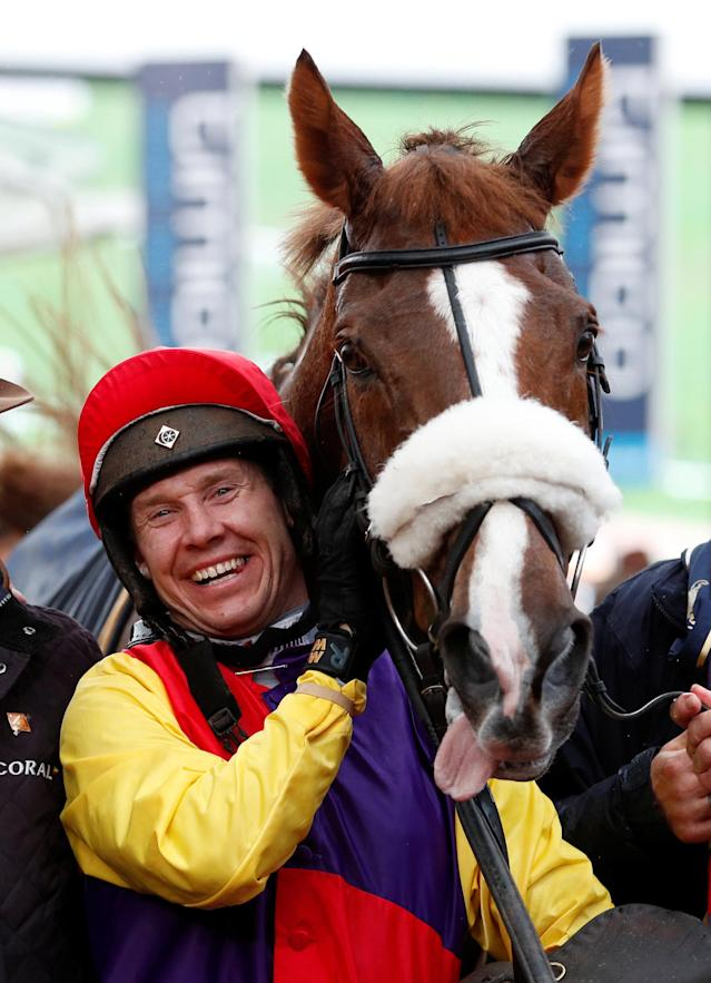 Horse Racing - Cheltenham Festival - Cheltenham Racecourse, Cheltenham, Britain - March 16, 2018 Richard Johnson on Native River celebrates after winning the 15.30 Timico Cheltenham Gold Cup Chase Action Images via Reuters/Andrew Boyers