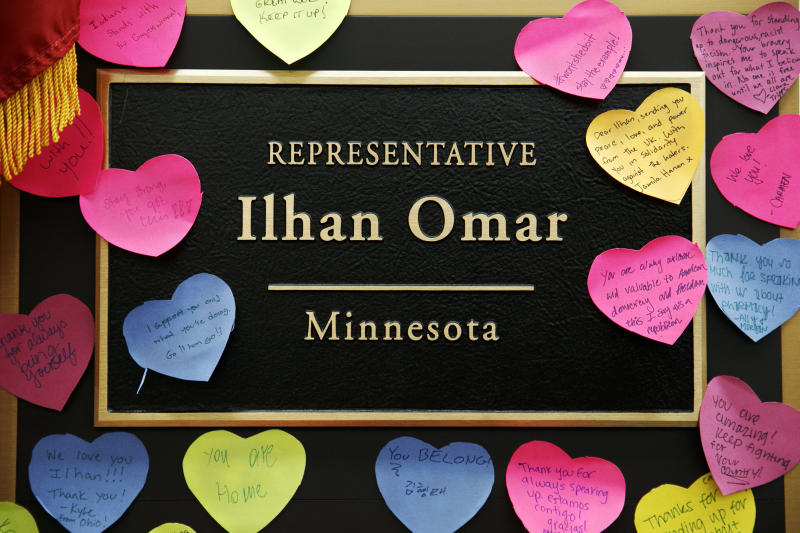 Heart shaped notes line the wall outside the office of Rep. Ilhan Omar, D-Minn., Friday, July 19, 2019, part of a day-long solidarity vigil organized by anti-war group Code Pink, on Capitol Hill in Washington. (AP Photo/Jacquelyn Martin)