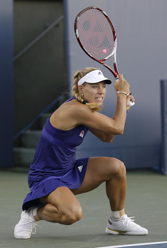 Angelique Kerber, from Germany, watches a return to Varvara Lepchenko, of the United States, during the first set of a semifinal in the Bank of the West Classic tennis tournament in Stanford, Calif., Saturday, Aug. 2, 2014. (AP Photo/Jeff Chiu)