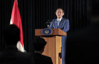 Japanese Prime Minister Yoshihide Suga speaks to the media during a press conference in Jakarta, Indonesia, Wednesday, Oct. 21, 2020. Suga is on a four-day visit to Vietnam and Indonesia. (AP Photo/Dita Alangkara, Pool)