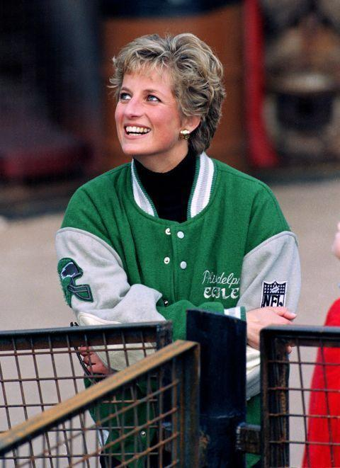 <p>Even Diana could make a letterman jacket look chic. Here, she sports one from the Philadelphia Eagles while attending a game at Alton Towers Theme Park in the spring of 1994.</p>