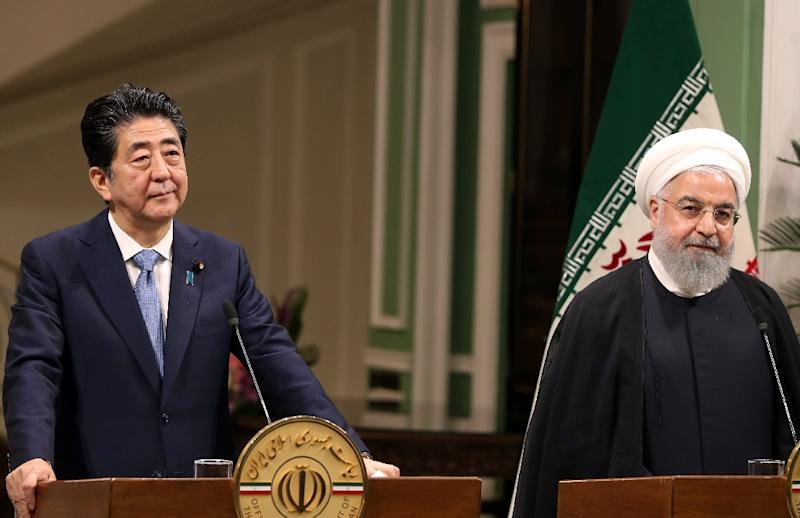 Iranian President Hassan Rouhani (R) gives a joint press conference with the Japanese Prime Minister Shinzo Abe in the capital Tehran on Wednesday (AFP Photo/-)