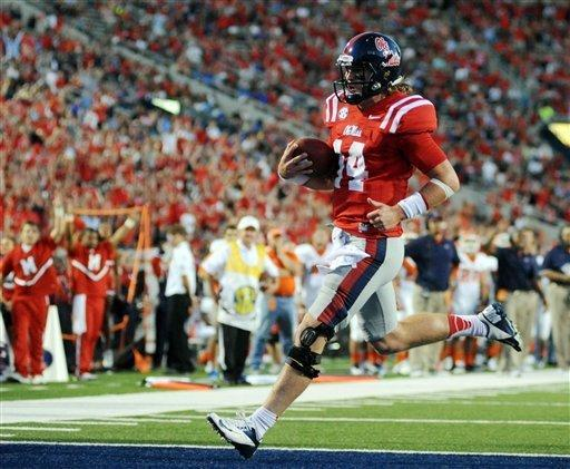 Mississippi quarterback Bo Wallace (14) scores a touchdown during an NCAA college football game against UTEP on Saturday, Sept. 8, 2012, in Oxford, Miss. (AP Photo/The Oxford Eagle, Bruce Newman)