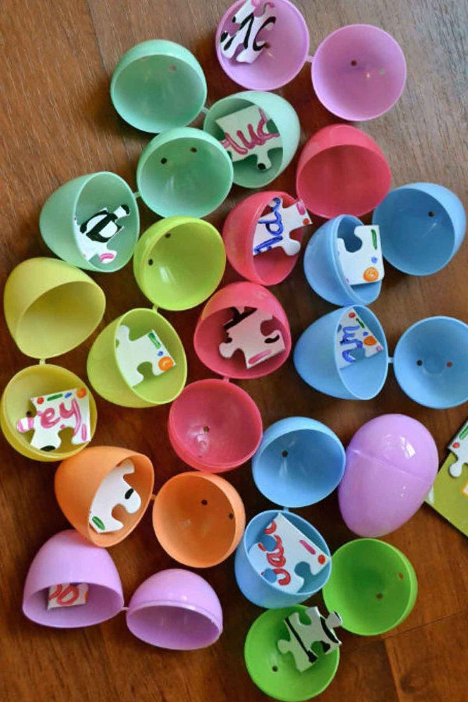 """<p>Put a fun twist on the traditional Easter egg hunt by hiding the pieces of a puzzle inside the eggs. First one to find all the pieces and finish the puzzle wins!</p><p><em>Get the tutorial at <a href=""""http://makethebestofeverything.com/2013/02/puzzle-easter-egg-hunt.html"""" rel=""""nofollow noopener"""" target=""""_blank"""" data-ylk=""""slk:Make The Best of Everything"""" class=""""link rapid-noclick-resp"""">Make The Best of Everything</a>.</em></p>"""