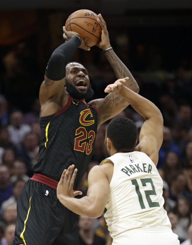 Cleveland Cavaliers' LeBron James (23) shoots against Milwaukee Bucks' Jabari Parker (12) in the first half of an NBA basketball game, Monday, March 19, 2018, in Cleveland. (AP Photo/Tony Dejak)