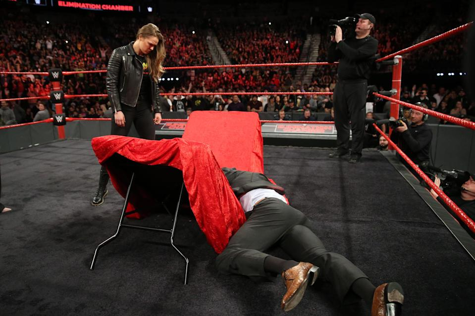 "Ronda Rousey tossed Triple H through a table at WWE's ""Elimination Chamber"" on Sunday night in Las Vegas. (Photo courtesy WWE)"