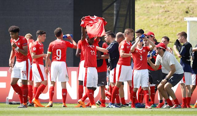Soccer Football - UEFA European Under-17 Championship - Group A - Switzerland v Israel - St George's Park Stadium, Burton Upon Trent, Britain - May 7, 2018 Switzerland's Felix Khonde Mambimbi celebrates with team mates after scoring the first goal Action Images via Reuters/Carl Recine