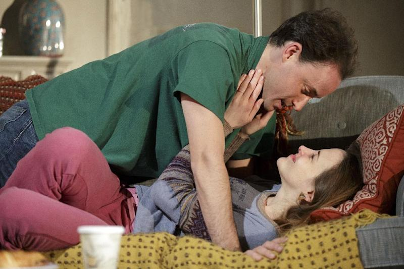 "This theater image released by Richard Kornberg & Associates shows Greg Keller, top, and Maria Dizzia in a scene from Amy Herzog's new play, ""Belleville"", performing off-Broadway at New York Theatre Workshop in New York.  (AP Photo/Richard Kornberg & Associates, Joan Marcus)"
