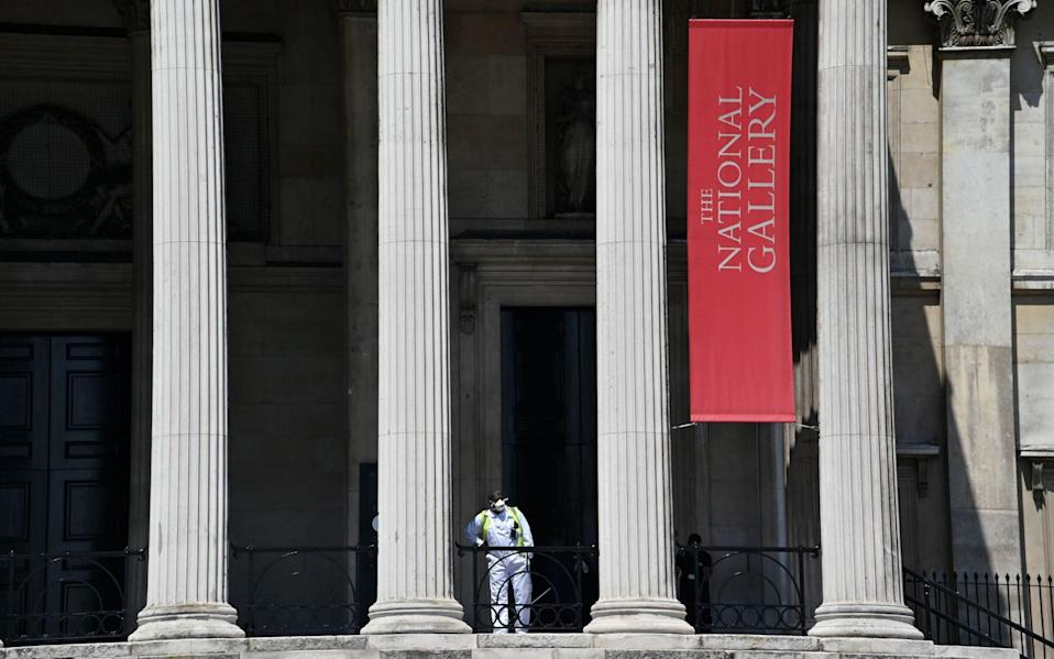A lone worker in a face mask outside The National Gallery - Justin Tallis/AFP
