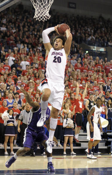 Gonzaga's Elias Harris (20) goes up for the dunk against Portland in the first half of an NCAA college basketball game on Saturday, March 2, 2013, in Spokane, Wash. (AP Photo/Jed Conklin)