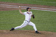 Virginia pitcher Griff McGarry (25) throws a pitch against Mississippi State in the sixth inning during a baseball game in the College World Series Tuesday, June 22, 2021, at TD Ameritrade Park in Omaha, Neb. (AP Photo/John Peterson)
