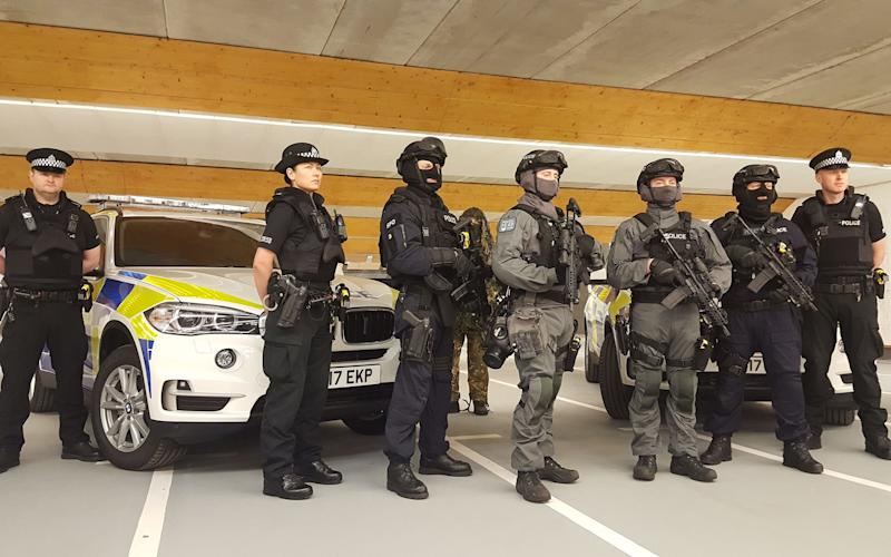 Armed police - Credit: PA