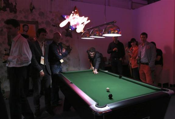 Visitors play pool in the Globe bar in the Olympic Village built for the London 2012 Olympic Games in Stratford, east London on June 29, 2012.