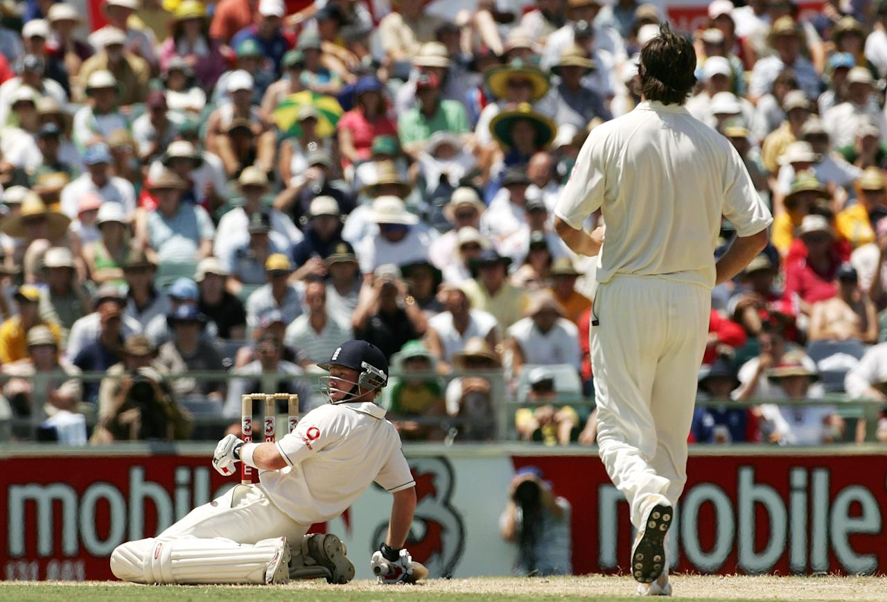 PERTH, AUSTRALIA - DECEMBER 17:  Ian Bell of England is floored by a bouncer from Glenn McGrath of Australia during day four of the third Ashes Test Match between Australia and England at the WACA on December 17, 2006 in Perth, Australia.  (Photo by Hamish Blair/Getty Images)