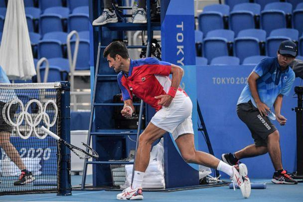 PHOTO: Serbia's Novak Djokovic smashes his racket during his Tokyo 2020 Olympic Games men's singles tennis match for the bronze medal against Spain's Pablo Carreno Busta at the Ariake Tennis Park in Tokyo on July 31, 2021. (Tiziana Fabi/AFP via Getty Images)