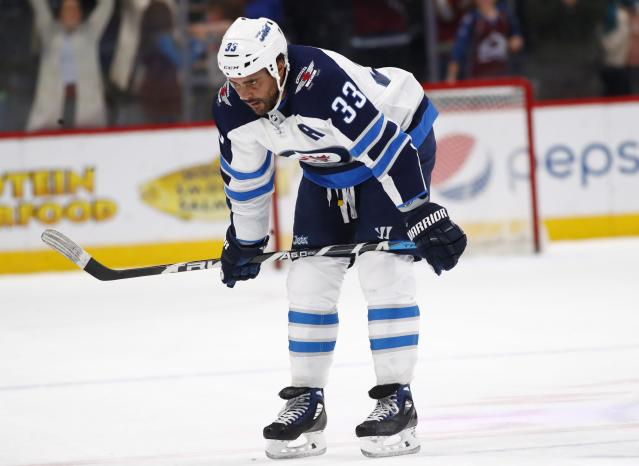 Byfuglien returned to action in a 3-2 loss to the Avalanche on Tuesday. (AP Photo/David Zalubowski)